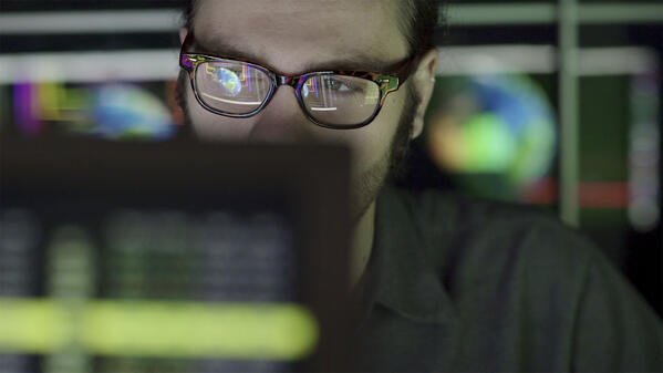 intelligence analyst working at a computer.