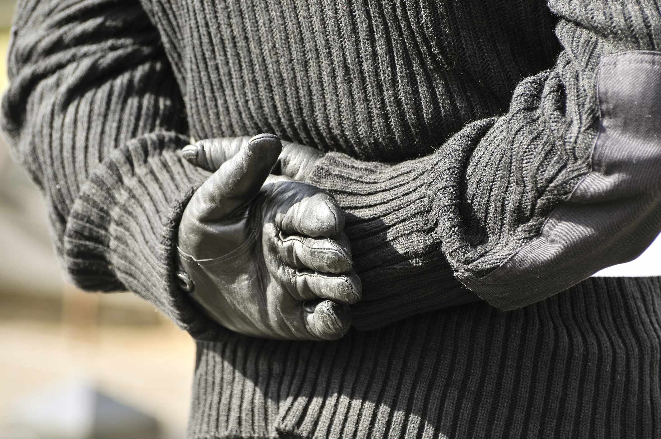 iStock-army militia gloves sweater man