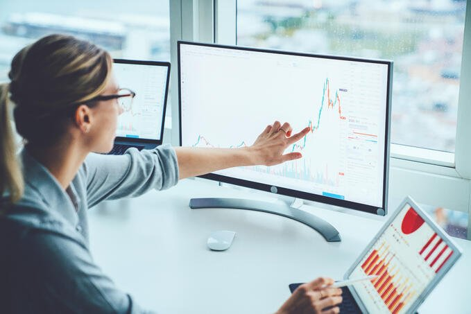 iStock-business risk graphs woman at desk charts tracking