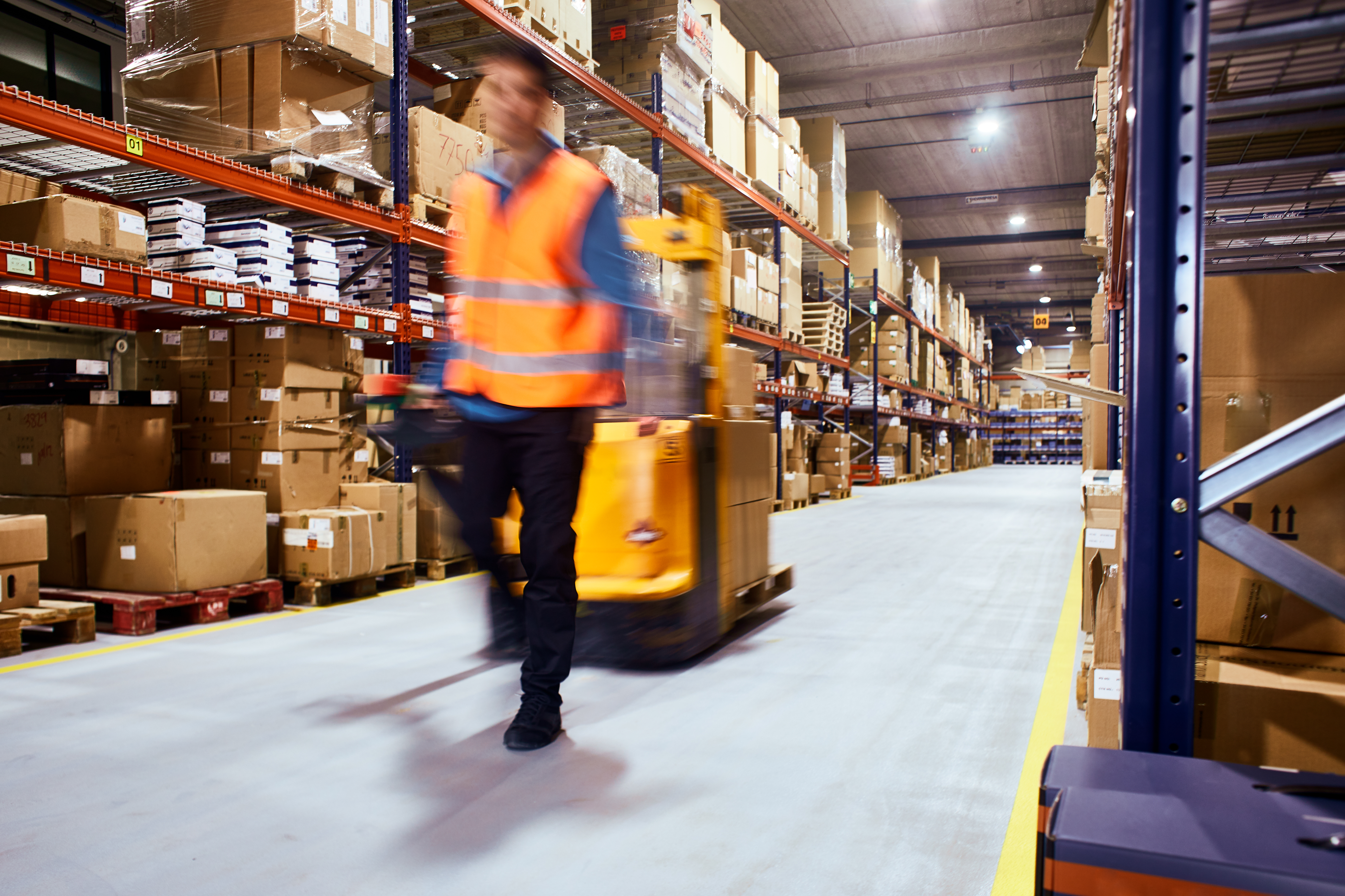 iStock-retail supply chain blur warehouse boxes