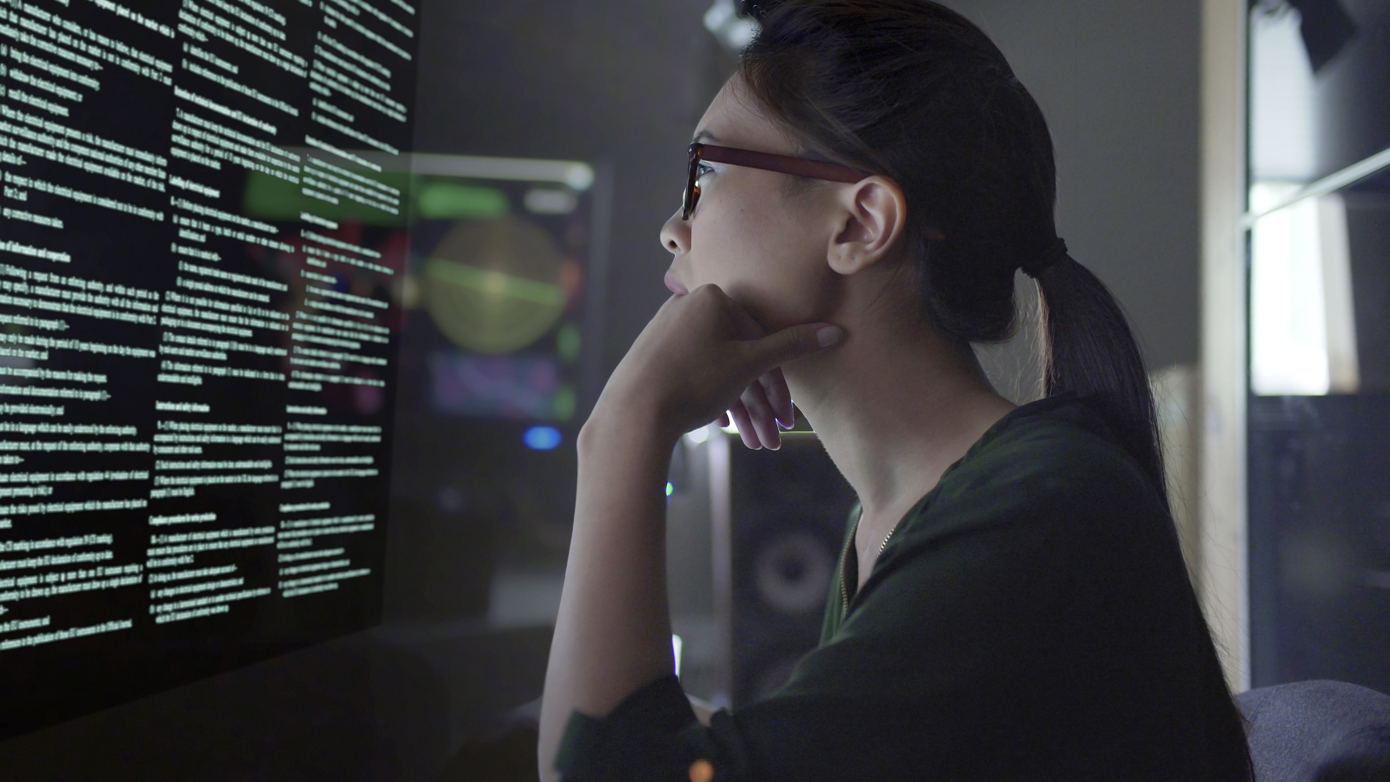 iStock-woman looking at data desktop investigate