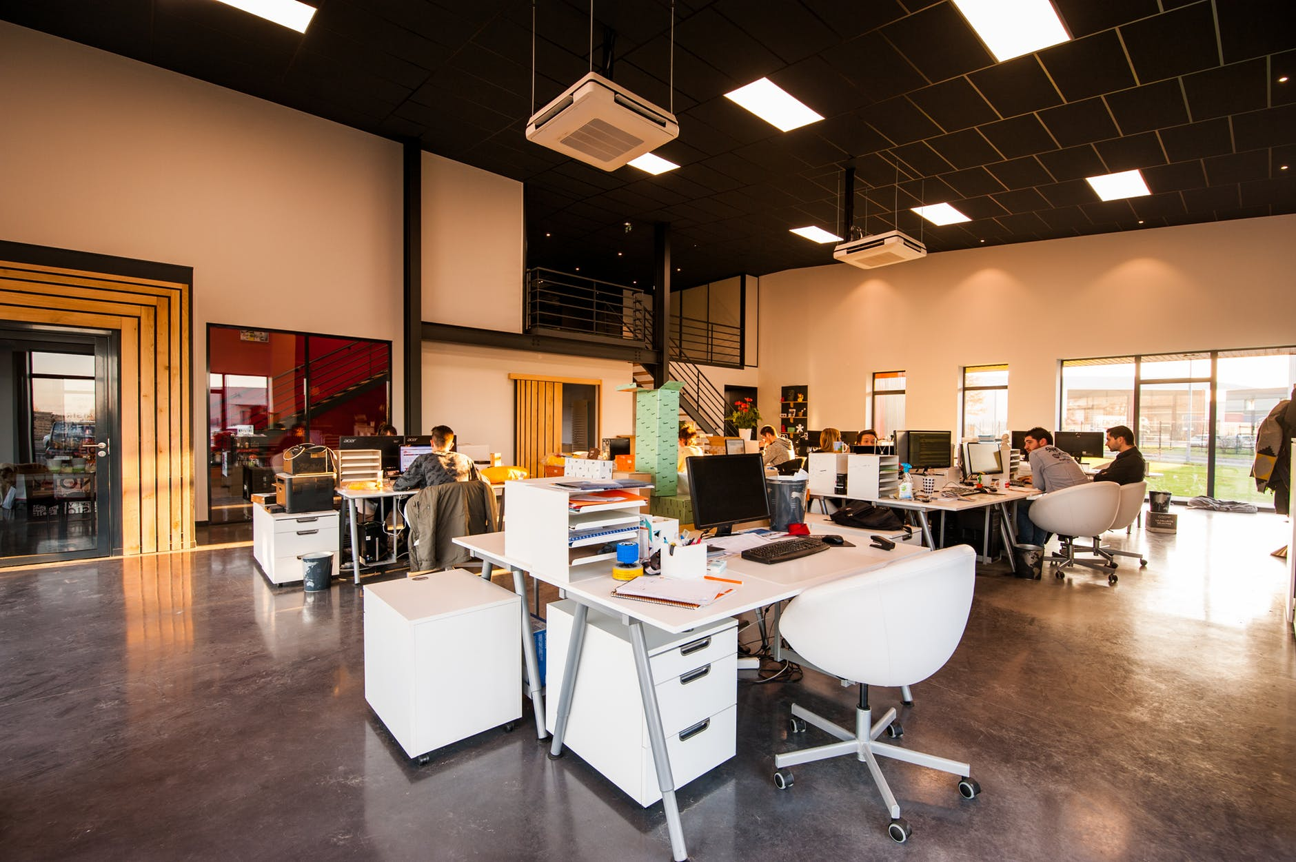 open office desks and people working