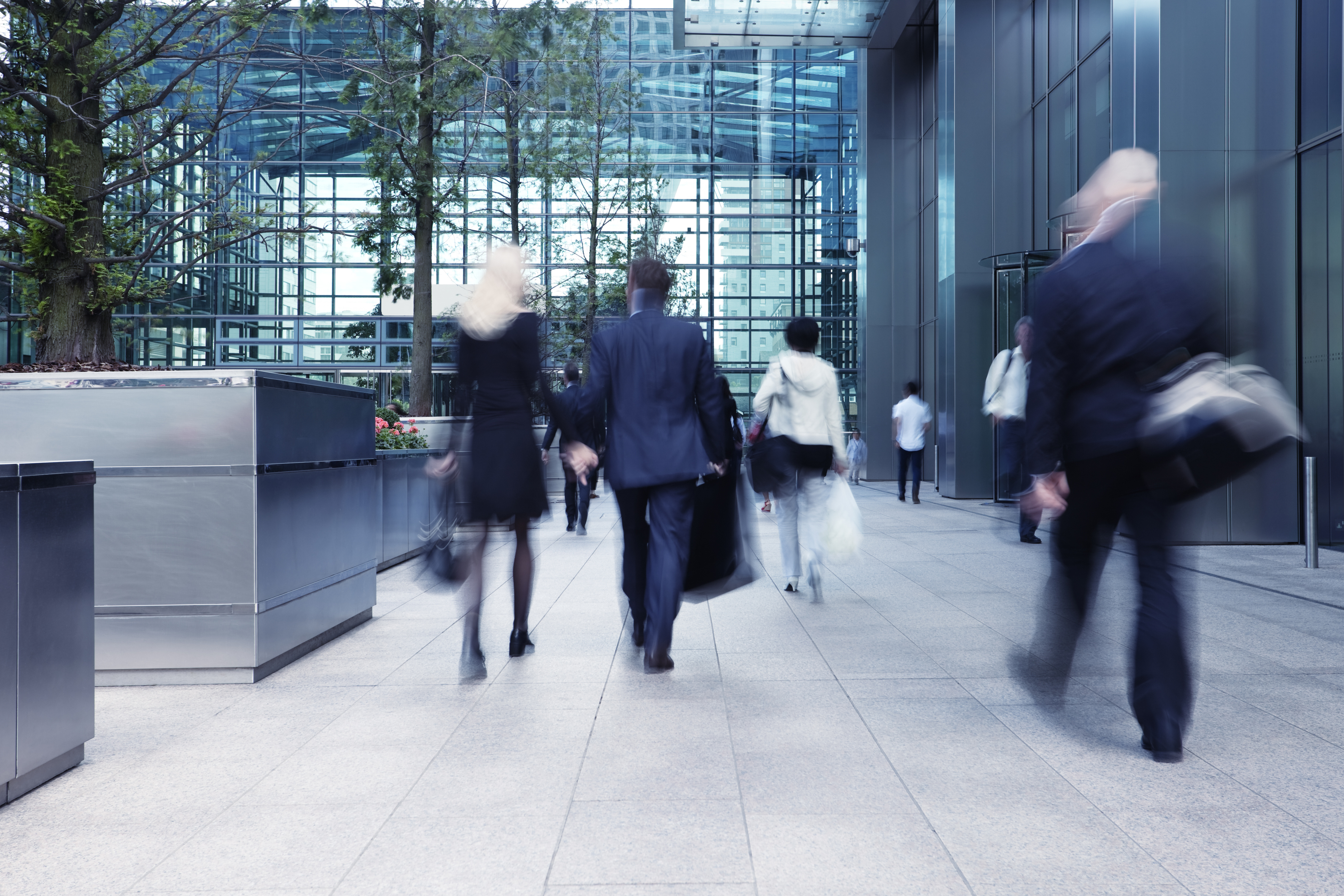 iStock-corporate blur building people going to work executive glass
